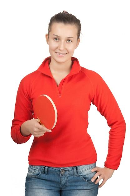 白で隔離されるラケットピンポンを持つ少女 Premium写真