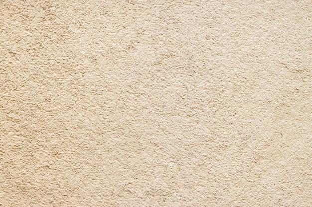 ベージュの明るい茶色の床のカーペットの生地のテクスチャ Premium写真