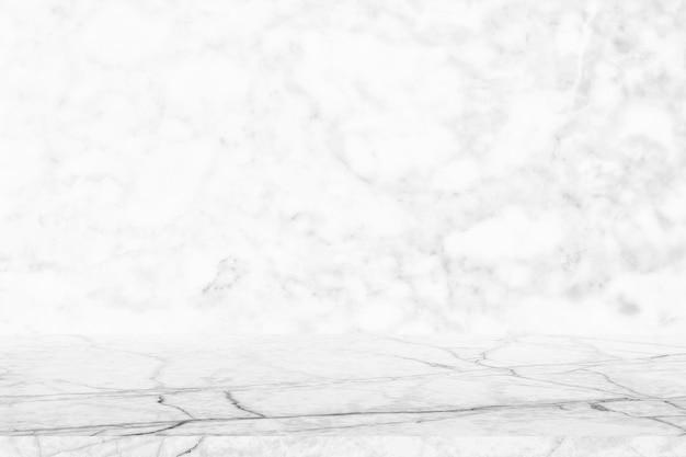 大理石の壁の上に空の大理石のテーブルトップ本物の大理石の表面テクスチャホワイトグレー Premium写真
