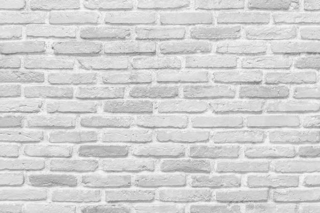 白いレンガの壁のテクスチャ背景 Premium写真