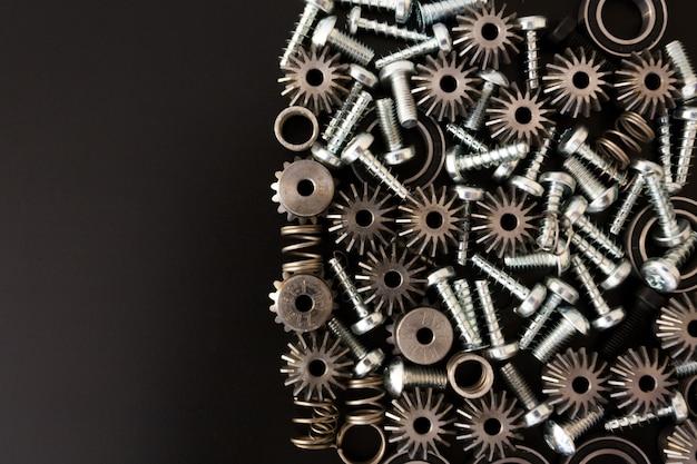 Механические компоненты на черном фоне. промышленные объекты Premium Фотографии