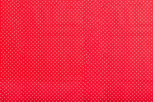 白のドットと赤のテクスチャ 無料写真