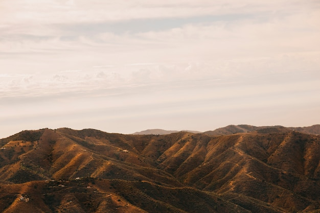 Холмистый пейзаж на закате Бесплатные Фотографии