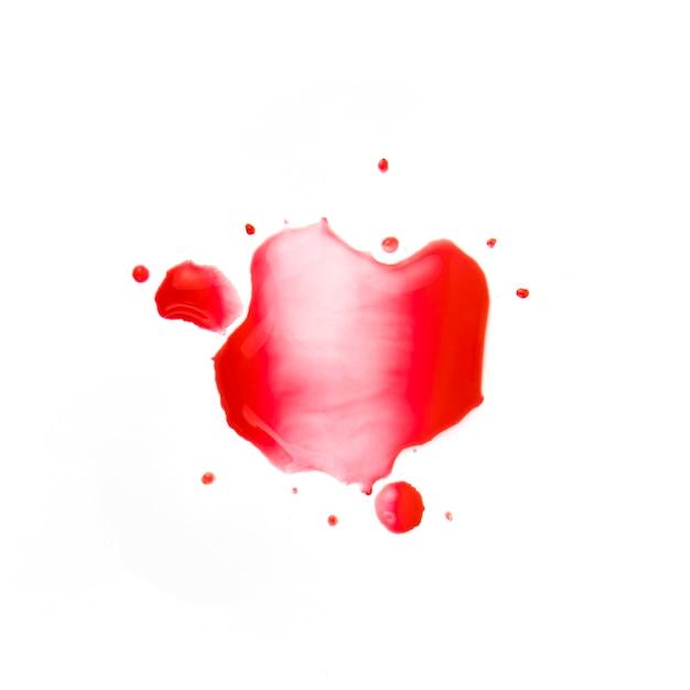 紙の上に小さな赤い染み 無料写真