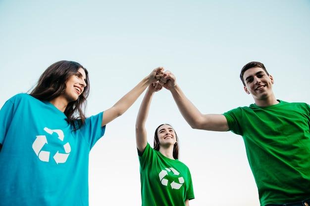Группа добровольцев, присоединяющихся к рукам Бесплатные Фотографии