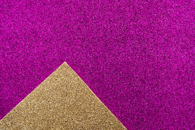 紫色の背景に黄金のカーペットのオーバーヘッドビュー 無料写真