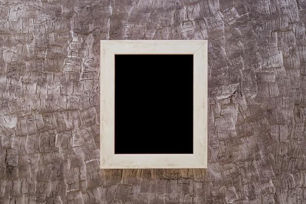 Черная рамка на окрашенной стене Бесплатные Фотографии