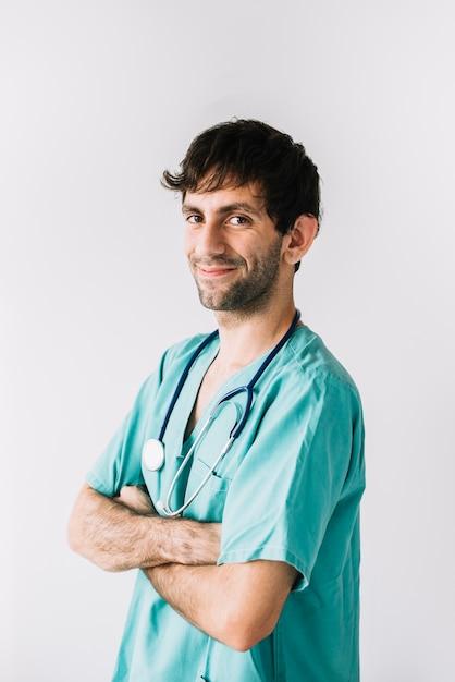 白い背景で幸せな男性医師の肖像 無料写真