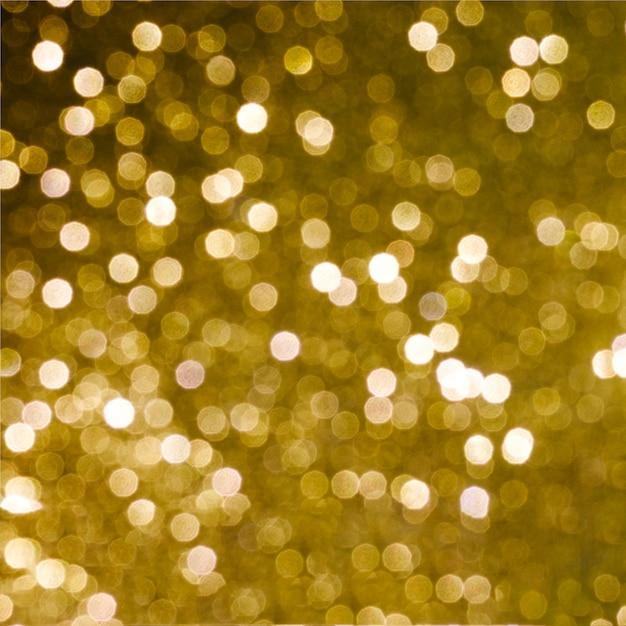 光沢のある金色の明るい背景 無料写真