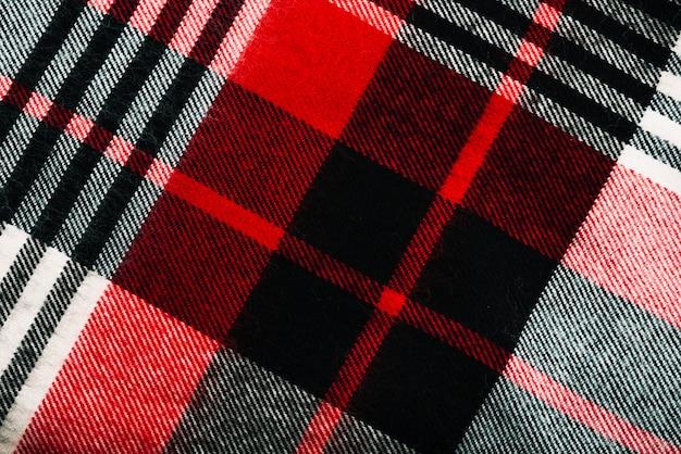 赤と黒の市松模様の織物 無料写真