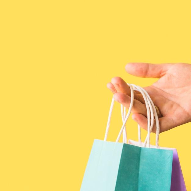 手の買い物のパケット 無料写真