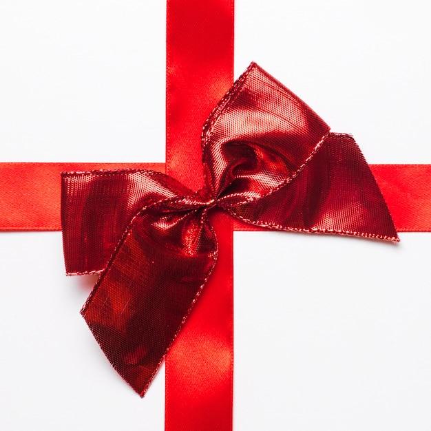 シルクリボンの赤いギフトの弓 無料写真