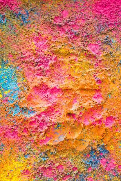 ホーリーの色が表面にランダムに散在する 無料写真