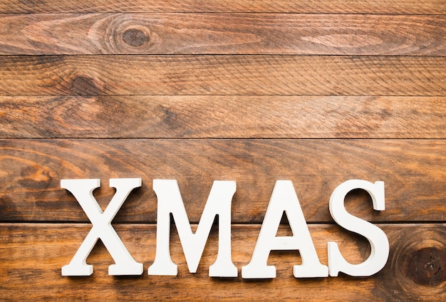 木製のボード上のクリスマスの碑文 無料写真