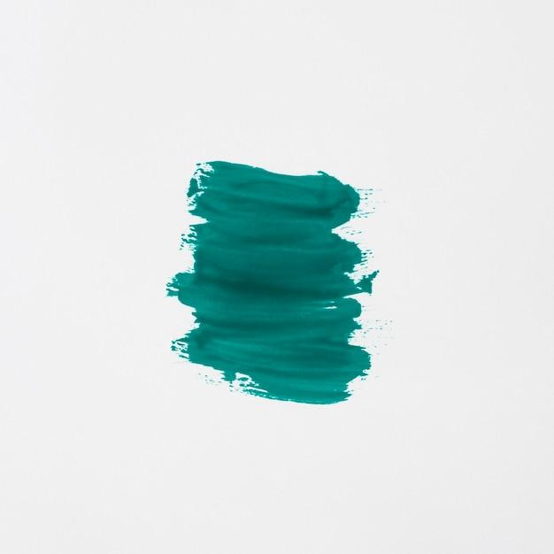 白い背景に分離された緑のマニキュアのストローク 無料写真