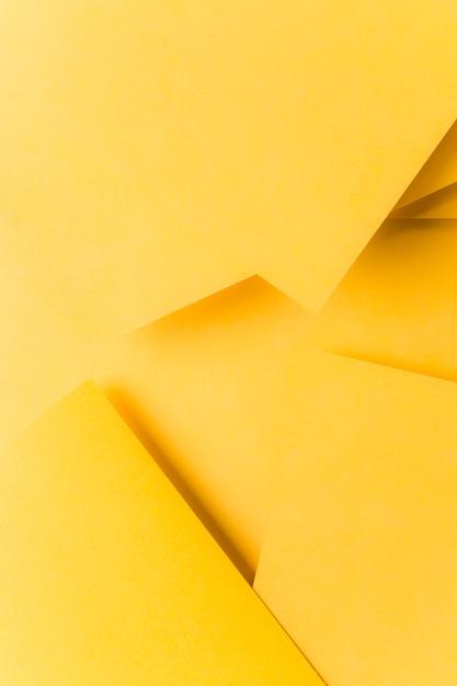 抽象的な黄色い折り紙の背景 無料写真