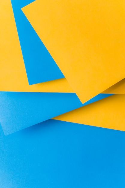 黄色と青のカード紙の背景の積み上げ 無料写真