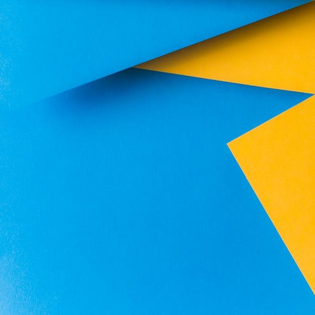 背景の黄色と青の紙の質感 無料写真