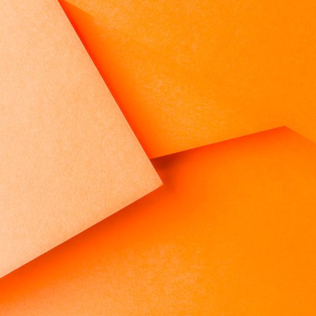 抽象的なオレンジ色の紙の背景デザイン 無料写真