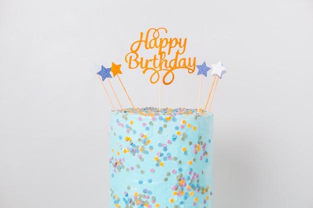 トッパー付きブルーの誕生日ケーキ 無料写真
