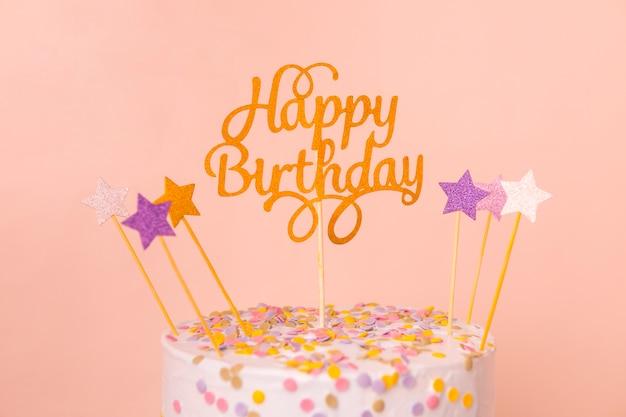 トッパー付きピンクの誕生日ケーキ 無料写真