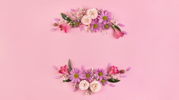 ピンクの背景に対して美しい花の装飾 無料写真