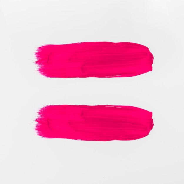 白地にピンクの抽象的な水彩ブラシストローク 無料写真
