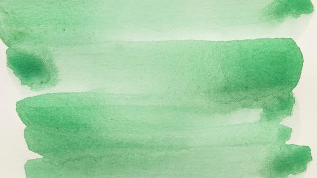 白い背景に対して緑色のブラシストロークのフルフレーム 無料写真