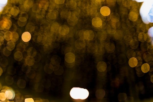 柔らかいぼかしボケライト効果と抽象的なゴールドの背景 無料写真