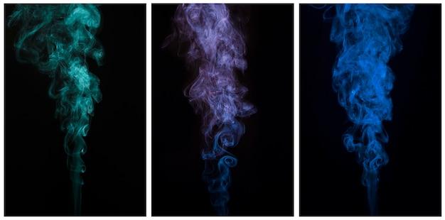 黒の背景に抽象的な移動煙の美しいセット 無料写真