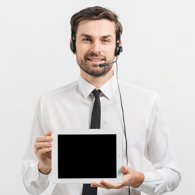 Агент колл-центра представляет шаблон планшета Бесплатные Фотографии