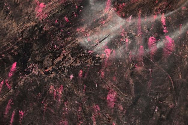 黒の織り目加工の木製の背景にピンクのホーリーカラー 無料写真
