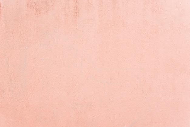 淡いパステル調のピンクの質感の壁の背景 無料写真