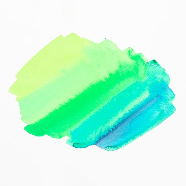白い背景に分離された緑と青の色合いの水彩画の汚れ 無料写真