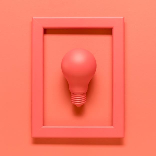 色付きの表面上のフレーム内のランプとピンクの組成 無料写真