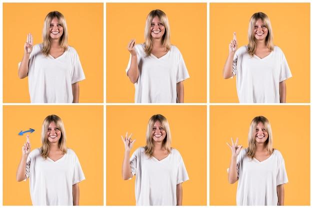 黄色の壁に対して聴覚障害者の兆しを見せて幸せな女のセット 無料写真