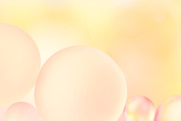 泡と柔らかい黄色の抽象的な背景 無料写真