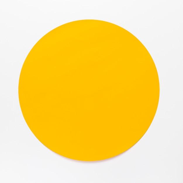 白い背景の上の平面図黄色い丸 無料写真