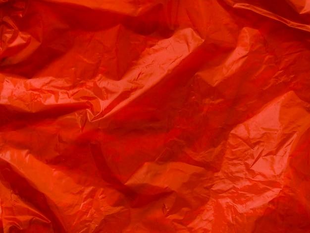明るい赤いしわくちゃのビニール袋の背景 無料写真