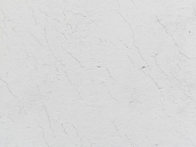 白いひびの入った壁のテクスチャ背景 無料写真