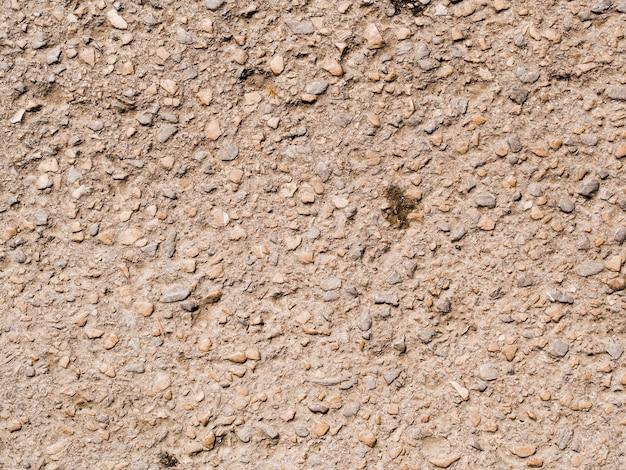 小さな石の背景を持つテクスチャ壁 無料写真