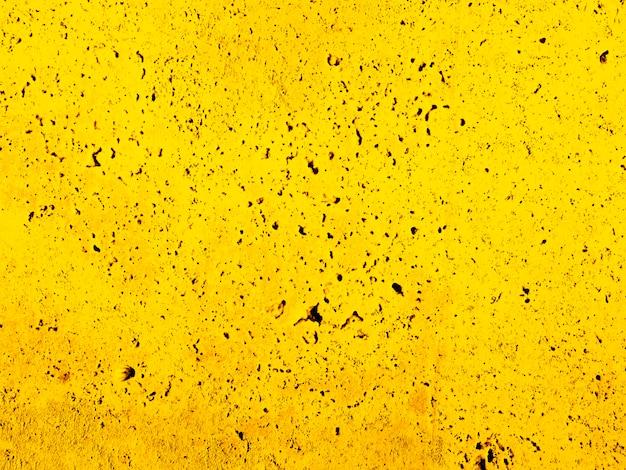 風化した黄色の壁のテクスチャ 無料写真