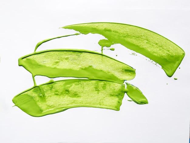 白い背景の上のオリーブグリーンのブラシストローク 無料写真