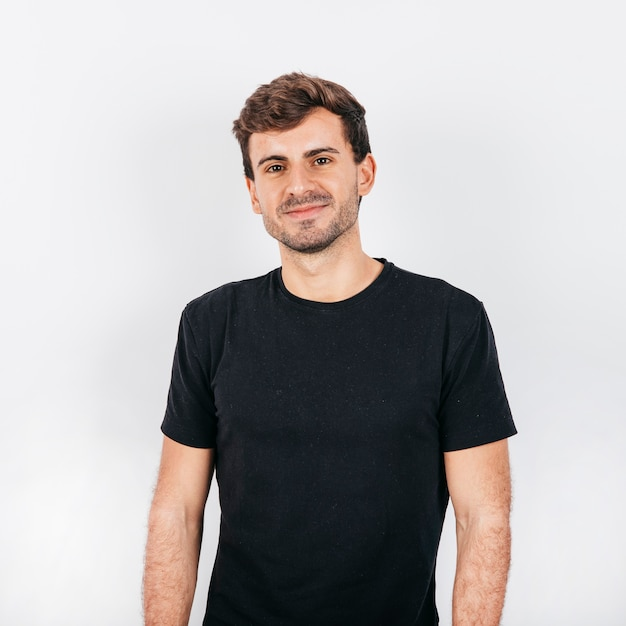 白い背景の上ハンサムな若い男 無料写真