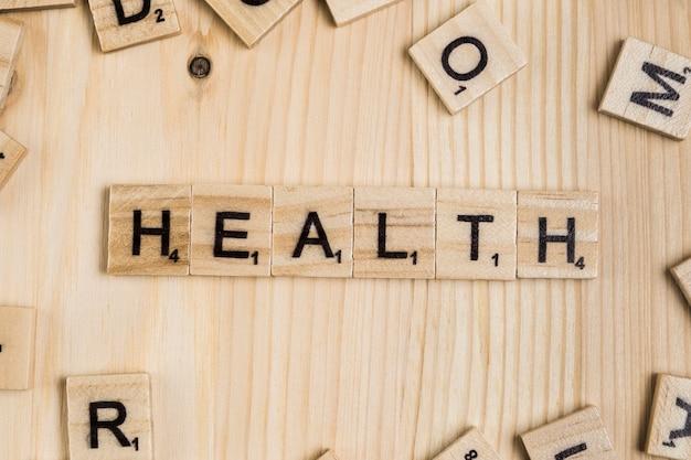 木製のタイル上の健康の言葉 無料写真