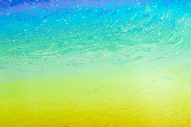 きらめく波状の青い緑と黄色の抽象的な背景 無料写真