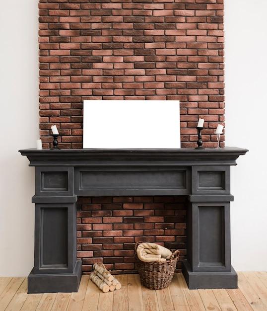 絵画モックアップとモダンなミニマリストの暖炉 無料写真