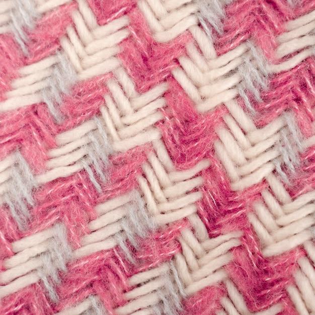 ピンクと白のウールパターンのフラットレイアウト 無料写真