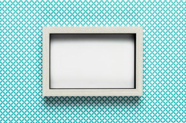 パターンの背景を持つレトロな白いフレーム 無料写真