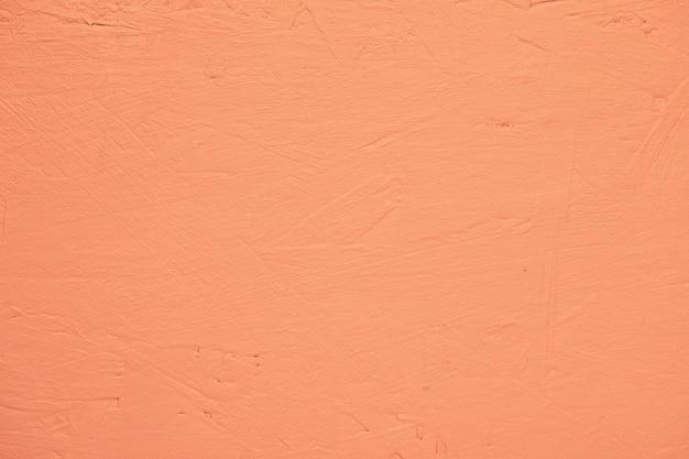 オレンジ塗装のテクスチャ壁 無料写真